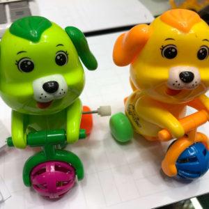 Заводная игрушка «Собака на велосипеде» оптом