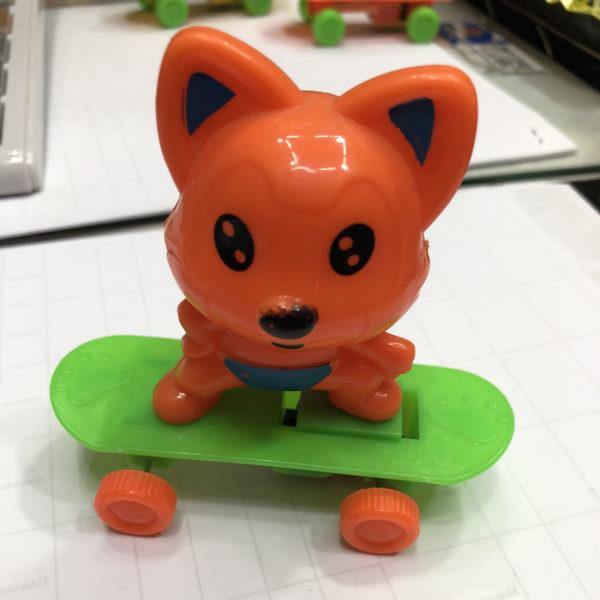 Заводная игрушка «Кот на скейте» оптом